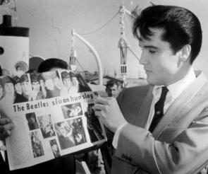 Elvis looking at Beatles magazine
