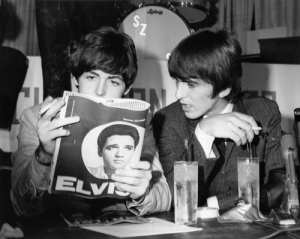 Paul McCartney reads Elvis Presley magazine